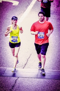 Jeri and son Michael crossing the finish line of the Cincinnati Flying Pic Half Marathon